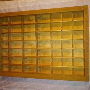 Antique wooden typesetters drawer.
